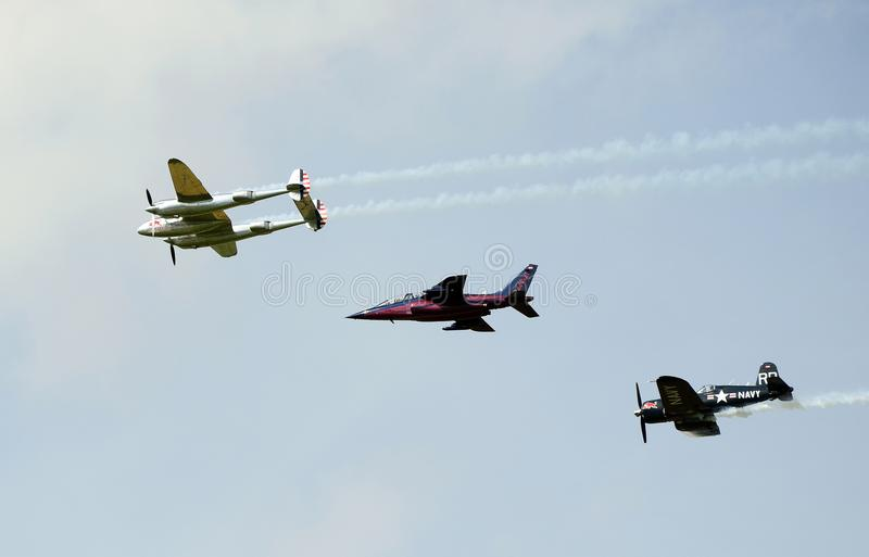 Airshow, Airpower 16,. Zeltweg, Styria, Austria - September 02, 2016: formation flight of Flying Bulls wirh Alpha Jet and vintage WWII fighter aircrafts P38 stock photography