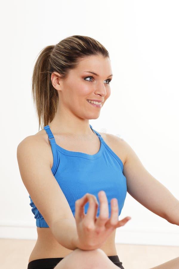 Zen attitude. Beautiful blond woman playing sports royalty free stock image