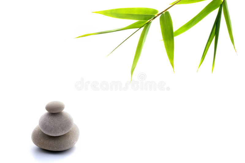 Zen background. Bamboo leavs and three stones isolated on white stock photo
