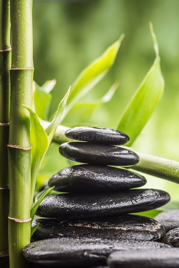 Zen basalt stones and bamboo royalty free stock photos