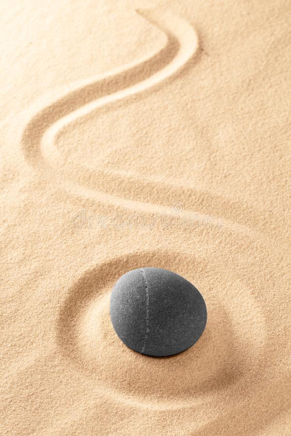 Zen Buddhism, medite and relax stone in raked Japanese sand garde stock photo