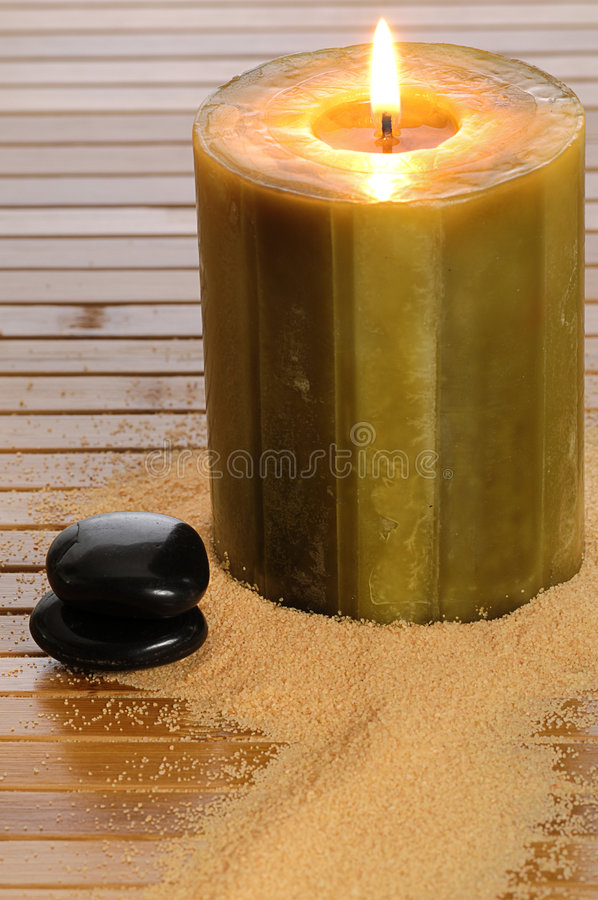 Zen candle and black stone stock image