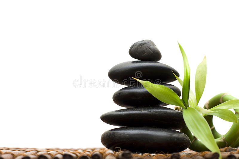 Zen concept with bamboo and stone royalty free stock photo