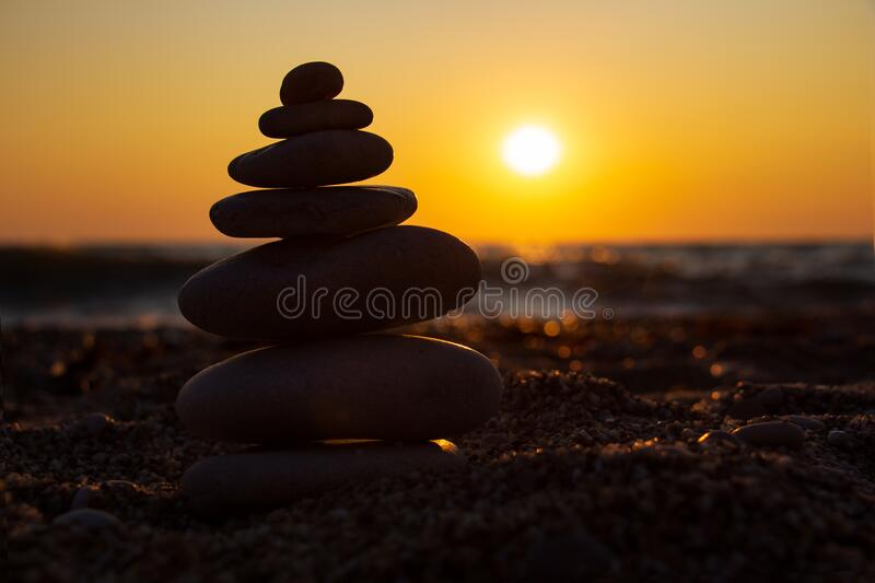 Zen concept. Sunset. The object of the stones on the beach at sunset.  Relax & Meditation. Zen stones stock photography