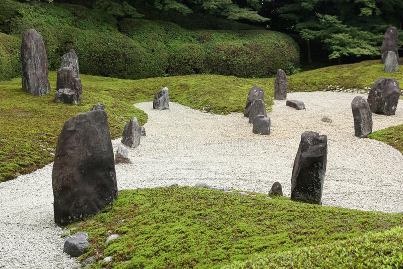 Zen garden in Kyoto Komyo-in. Japanese zen garden with big stones and raked gravel  in Kyoto Komyo-in temple royalty free stock photo