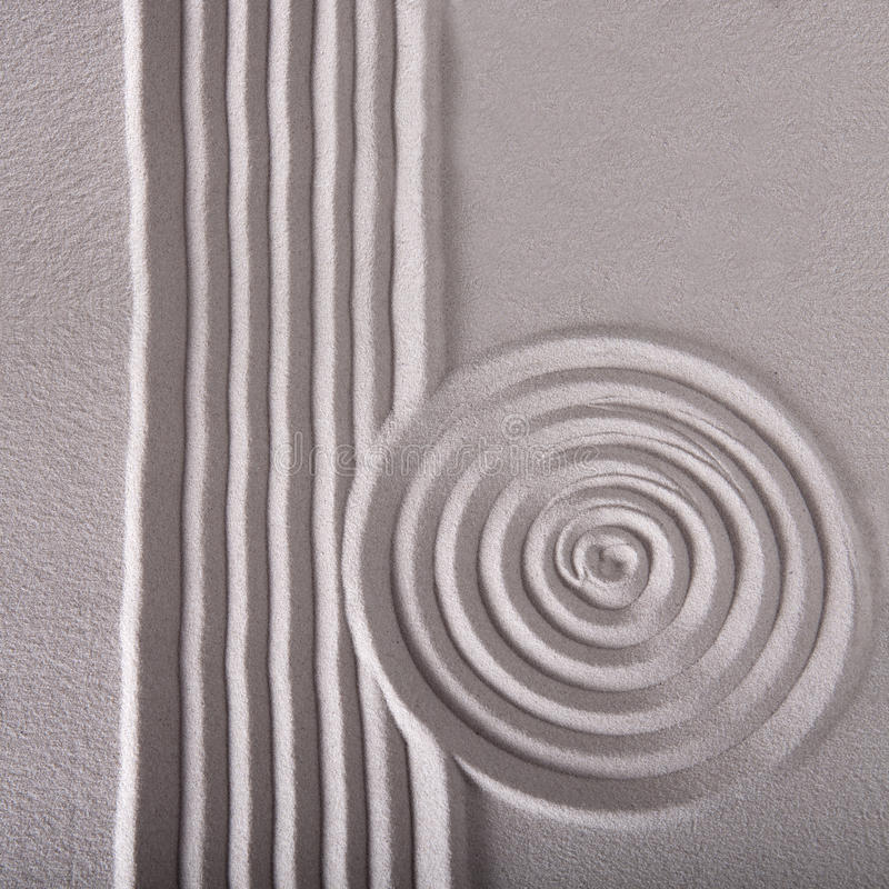 Zen garden lines and circle ripple pattern. Sand zen garden raked sand abstract for balance calmness spiritual and tranquil rippled pattern texture and circle royalty free stock photos