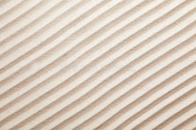 Zen garden pattern on sand as background, top view. stock photography