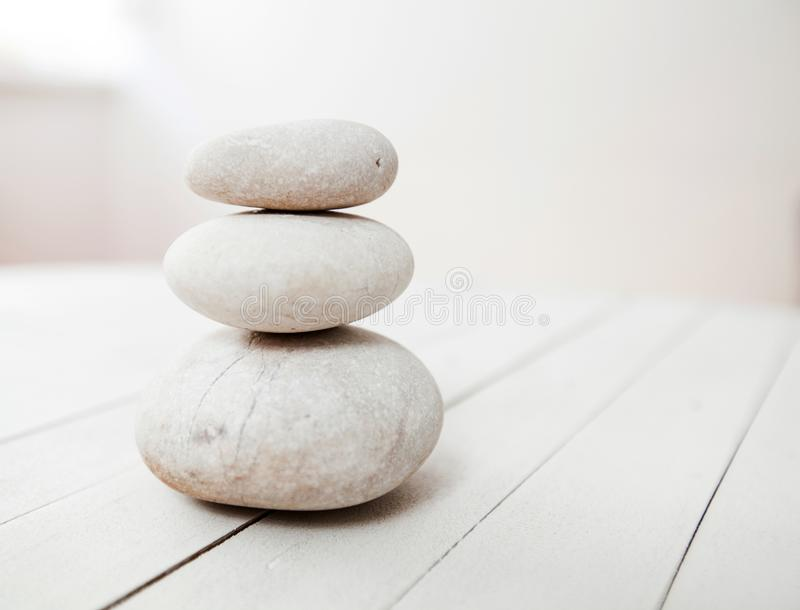 Zen Harmony Meditation. Stacked of stone, spa lifestyle, on white wooden background, space for message stock images