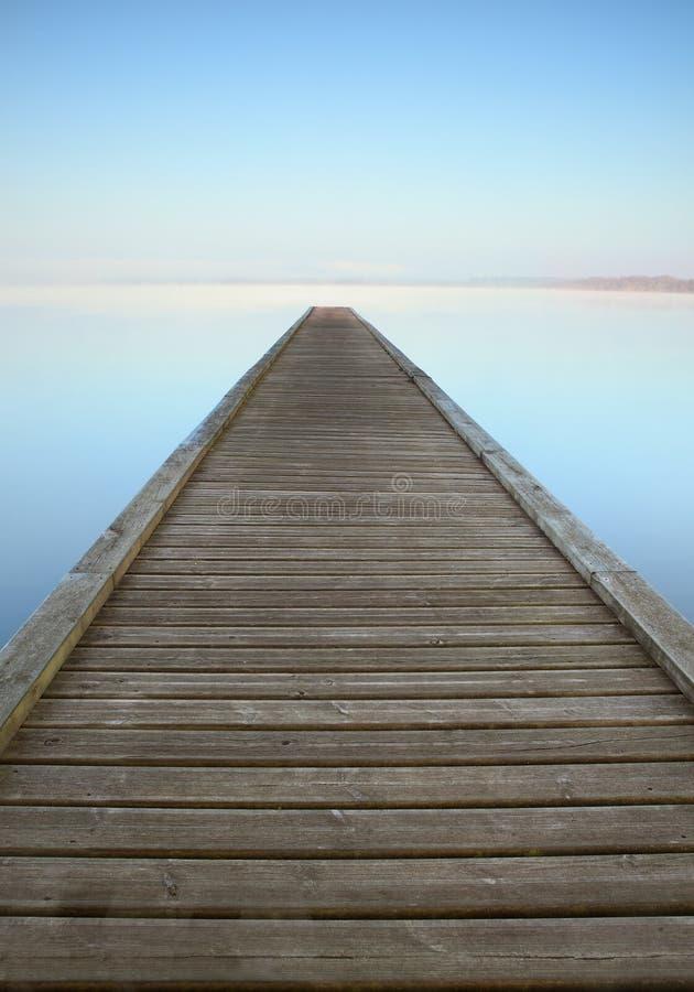 Zen jetty on misty lake royalty free stock photos