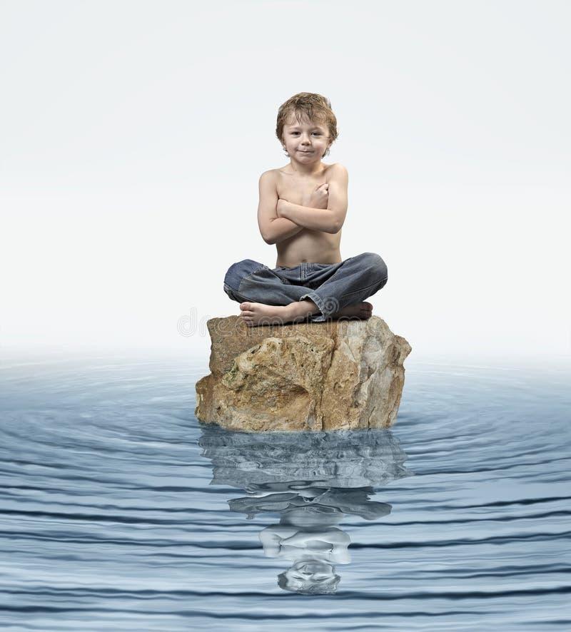 Zen Kid on rock in water royalty free stock photos