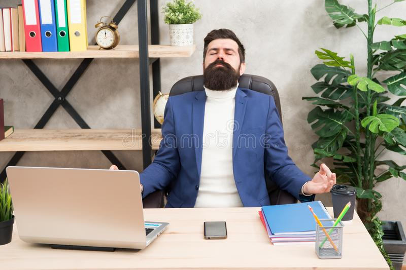 Zen like. Businessman meditate in formal outfit. Confident man relax on mediation. Boss meditate at workplace. Bearded royalty free stock photos