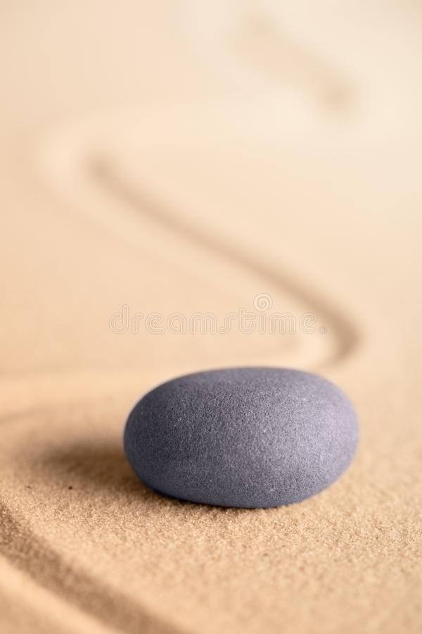 Zen meditation stone in a Japanese garden with raked sand stock images