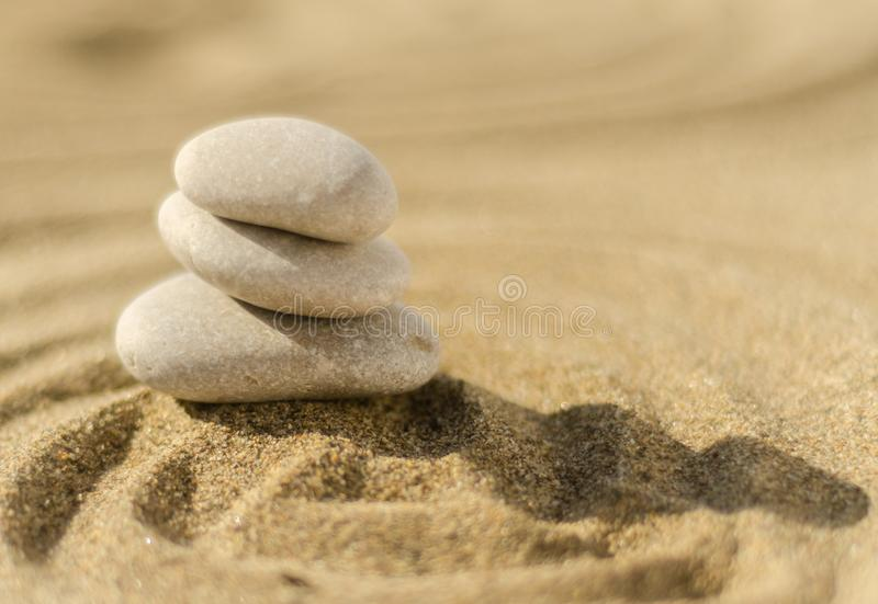 zen meditation stone in sand, concept for purity harmony and spirituality, spa wellness and yoga background stock image