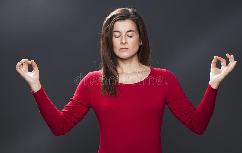 Zen relaxation for meditating 30s beautiful woman stock photography