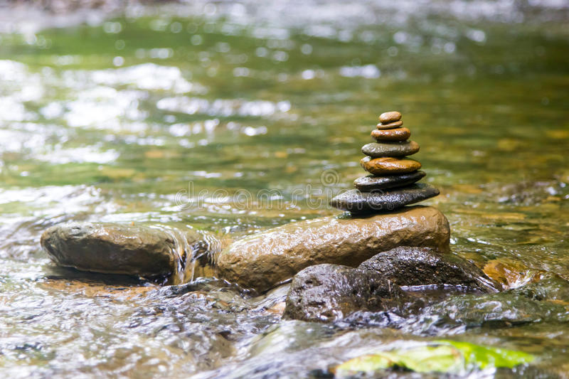 Zen river rock pile. And water royalty free stock photos
