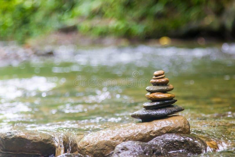 Zen rock pile. Over water stock photography