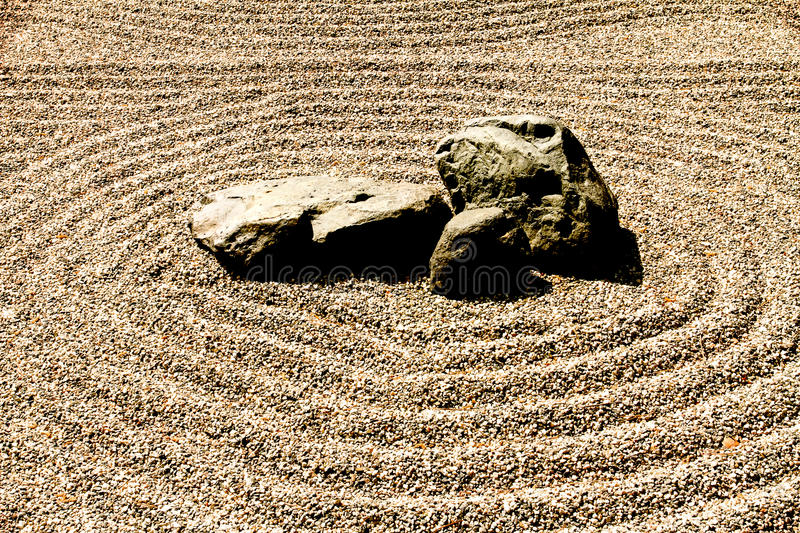 Zen rock and sand royalty free stock photography