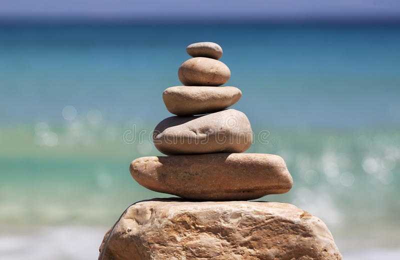 Zen rocks. On the beach with sea waves background royalty free stock photos