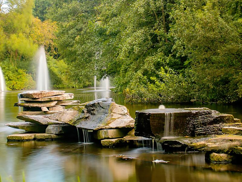 Rocks with small waterfalls stock images