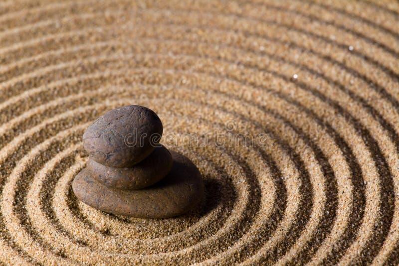 Zen sand stone garden. Balance round rock background, Zen sand stone garden royalty free stock photography