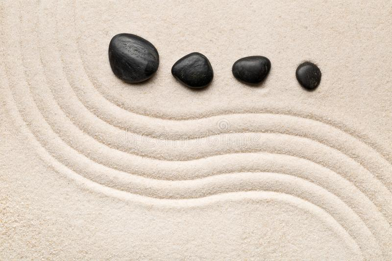 Zen sand and stone garden with raked curved lines. Simplicity, c stock photography