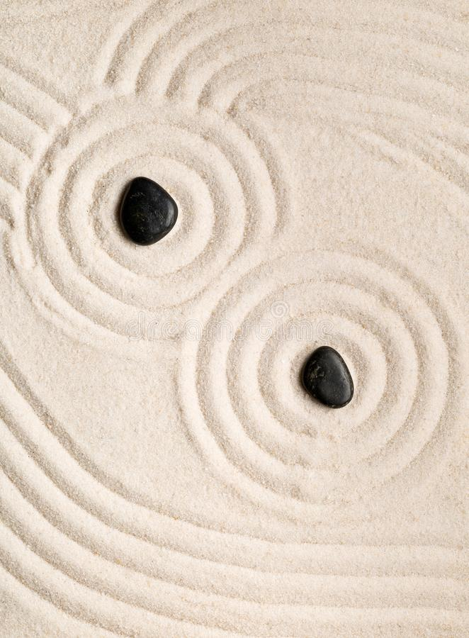 Zen sand and stone garden with raked lines, curves and circles. stock image