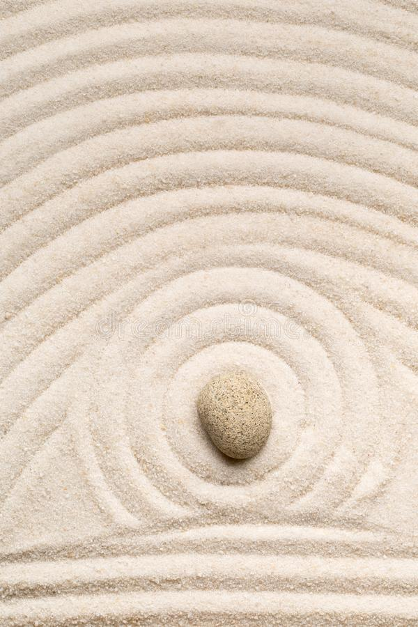 Zen sand and stone garden with raked lines, curves and circles. royalty free stock photo