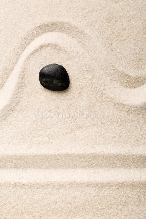 Zen sand and stone garden with raked lines and curves. Simplicity, concentration or calmness abstract concept stock photos