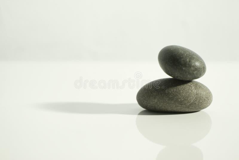 Zen schommelt wit stock afbeelding