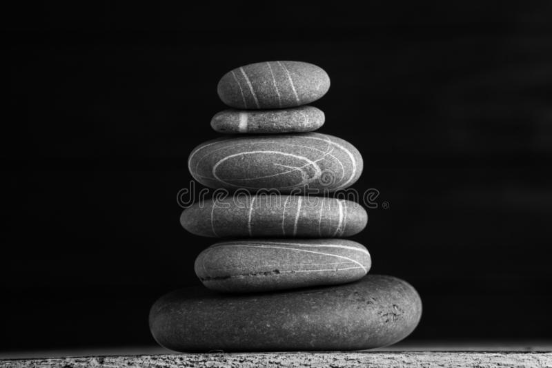 Zen sculpture. Harmony and balance, cairn, poise stones on wooden table.  stock photography
