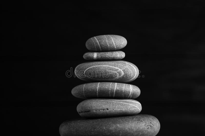 Zen sculpture. Harmony and balance, cairn, poise stones on wooden table.  stock photo