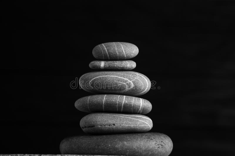 Zen sculpture. Harmony and balance, cairn, poise stones on wooden table.  stock photos