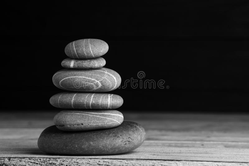 Zen sculpture. Harmony and balance, cairn, poise stones on wooden table.  stock image