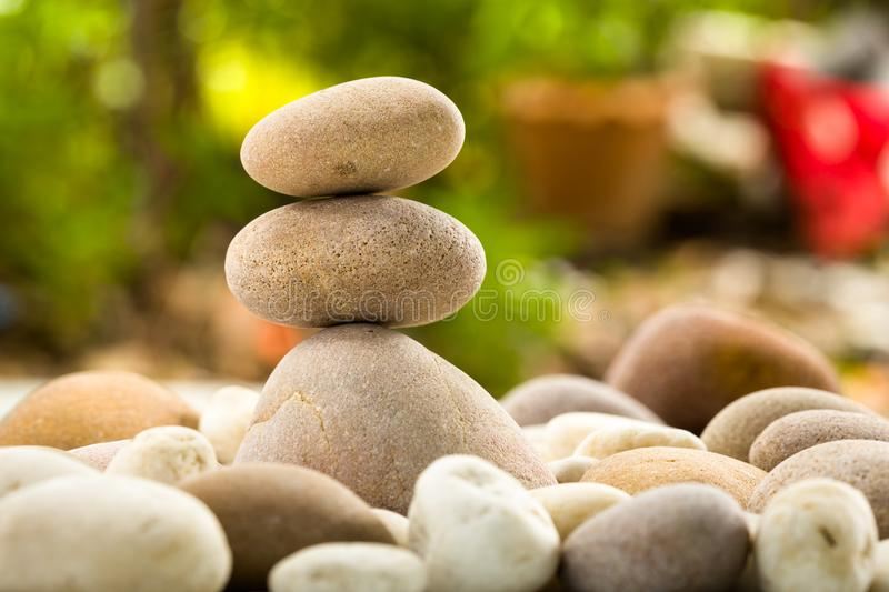 Zen stacked stones on nature background royalty free stock photography
