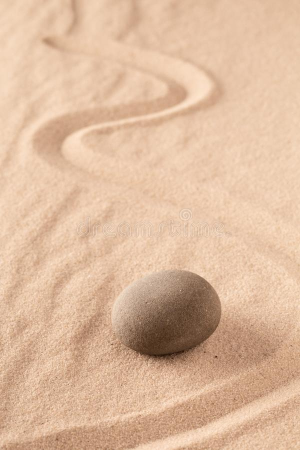 Zen stone Japanese meditation sand garden for focus and concentration on balance and spirituality royalty free stock photos