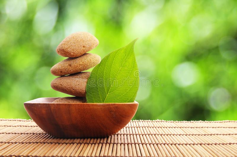 Zen stone with leaf royalty free stock photography