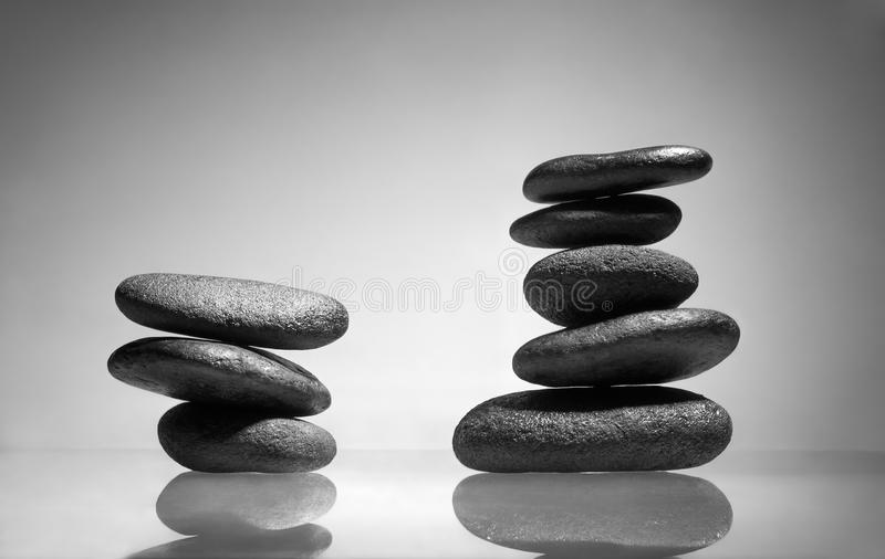 Spa Stones. Horizontal photo of two balanced zen stones arrangement with reflections. These stones are used in spa and wellness centers