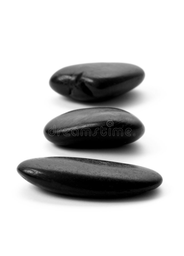 Zen stones. Three pebble stones in a row. isolated on white background royalty free stock photography