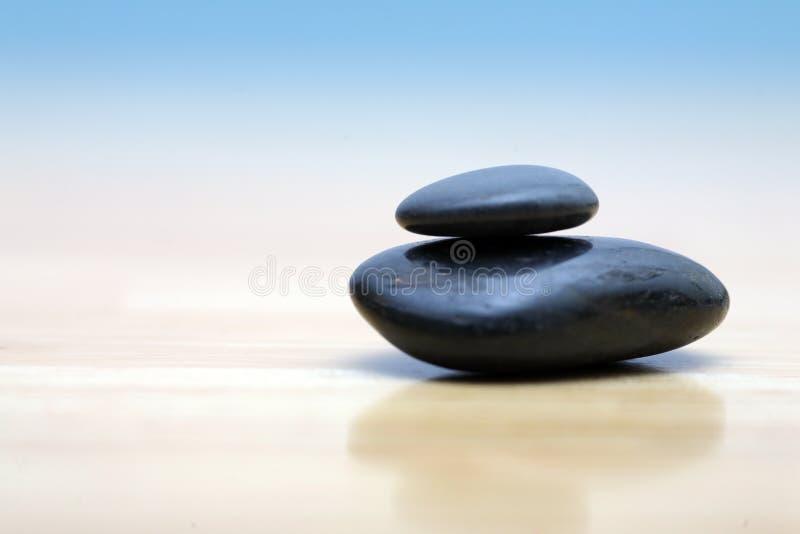 Zen stones. On wooden surface. Shallow DOF stock photos