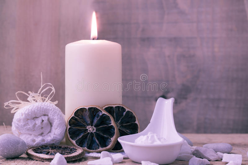 Zen stones aromatic candle table. Spa and wellness setting with candle and towel royalty free stock images