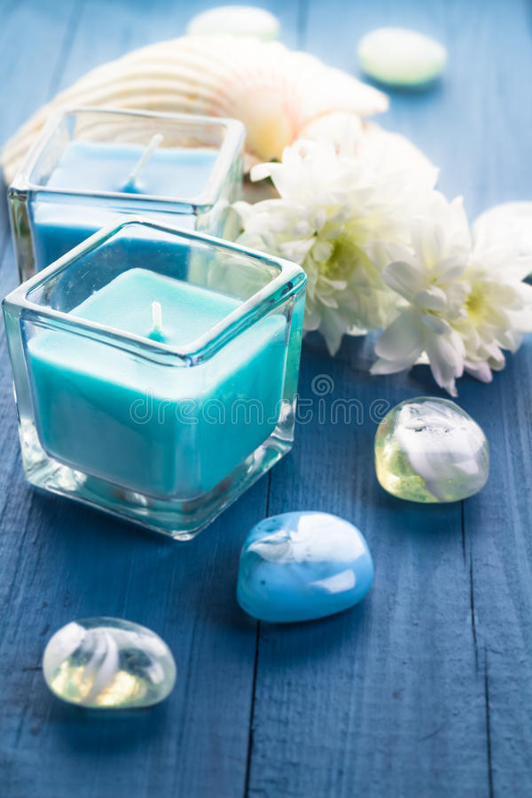 Zen stones aromatic candles wooden background royalty free stock photo