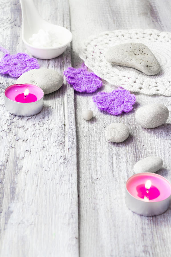 Zen stones aromatic candles wooden background stock photo