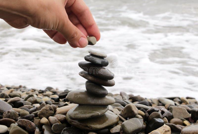 Zen stones balance stack on a seashore stock image