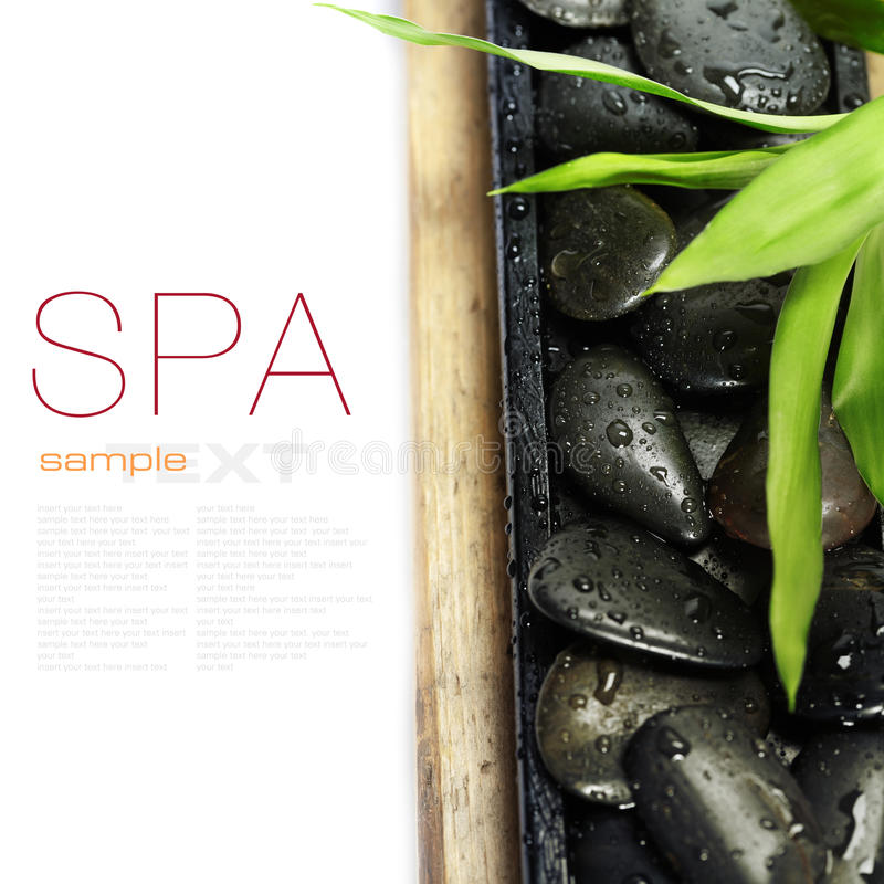 Zen stones and bamboo. Spa concept (zen stones and bamboo) on wooden board - with sample text stock image