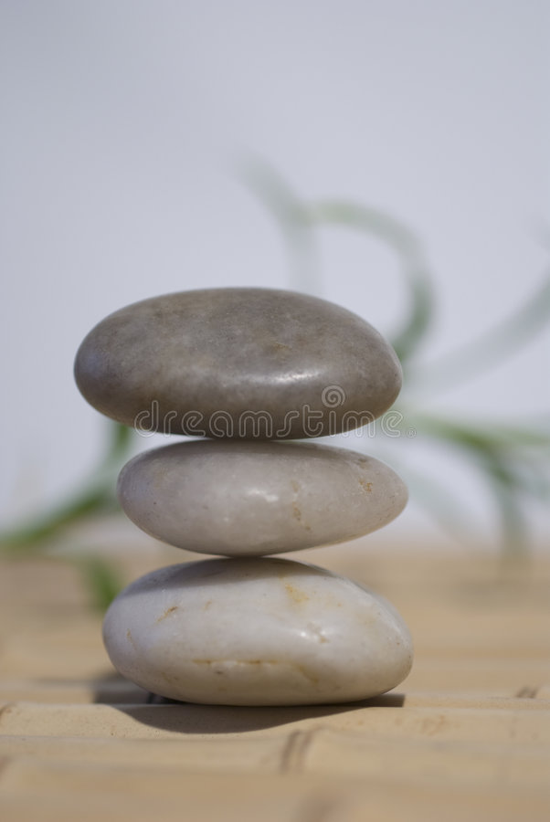 Zen stones and bamboo. Zen stones on bamboo meditation concept royalty free stock photos