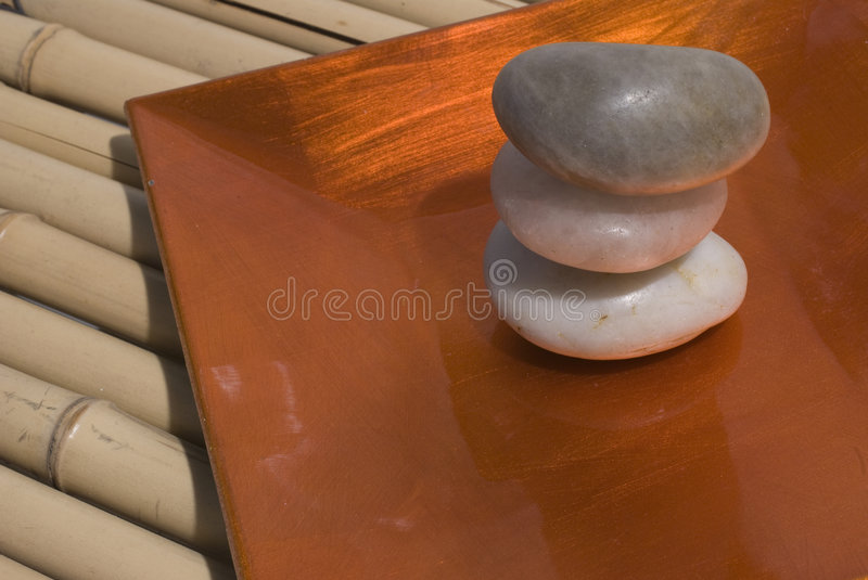 Zen stones and bamboo. Zen stones on bamboo background meditation concept royalty free stock photos