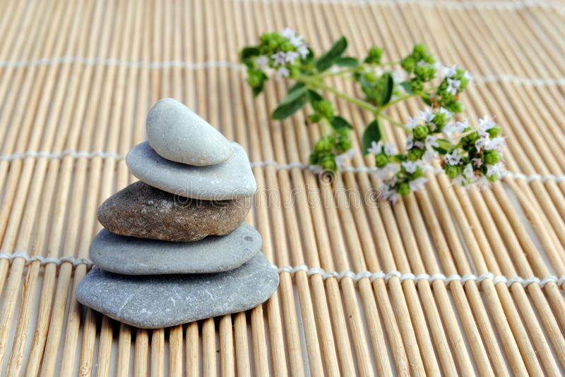 Zen stones on bamboo background. Concept of meditation, harmony, relax and wellness royalty free stock images