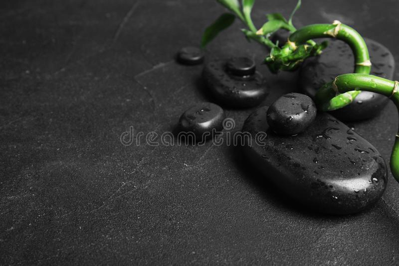 Zen stones and bamboo on dark background. Space for text stock photography