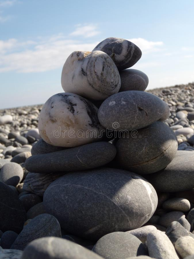 Zen stones on the beach. Abstract sea pebbles tower closeup. Concept of Stones balance and harmony pebbles stack on the beach stock images