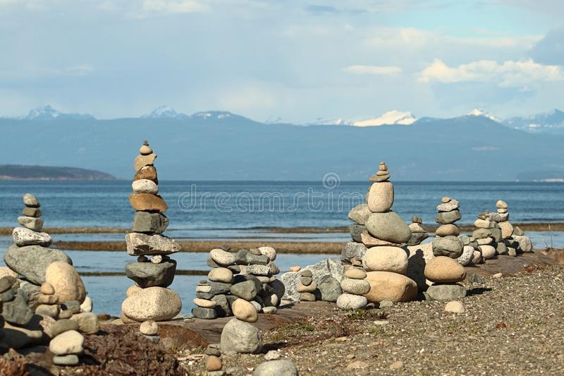 Zen stones on Parksville Beach, Vancouver Island, Canada. Stones piled in zen formations along rocky beach of Parksville Beach, Vancouver Island, Canada stock photo